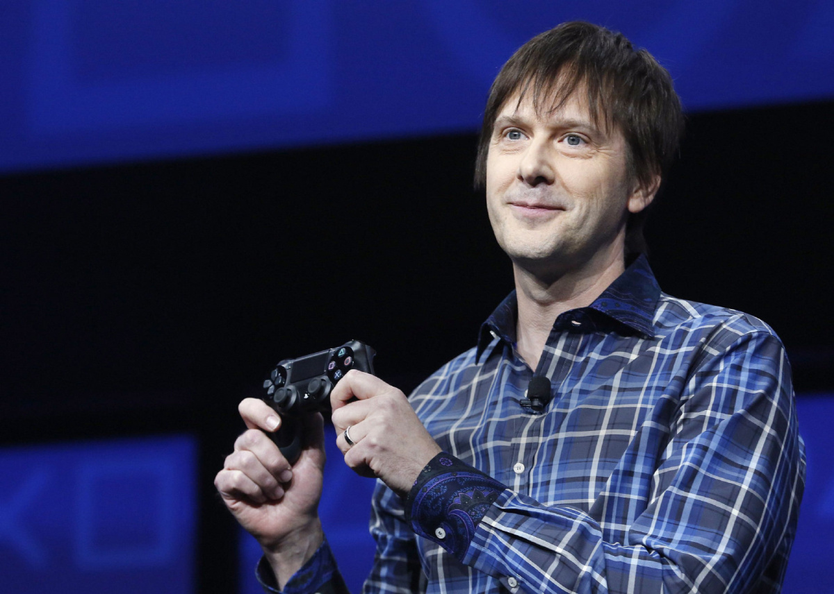 PlayStation 4's lead system architect Mark Cerny holds a gaming control device in New York